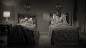 A couple of beds in a room Description automatically generated with medium confidence